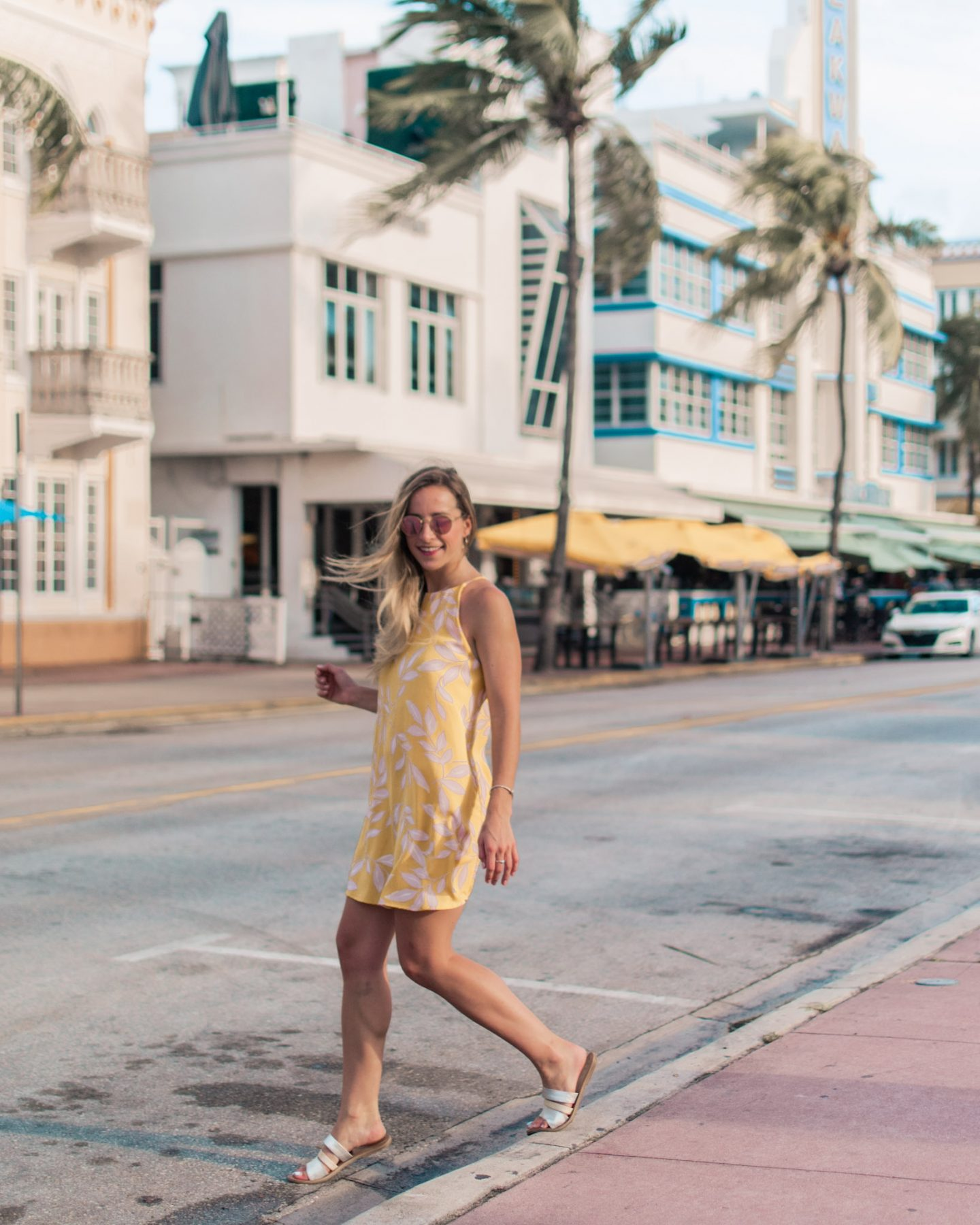 miami travel guide a girl in a yellow dress in south beach
