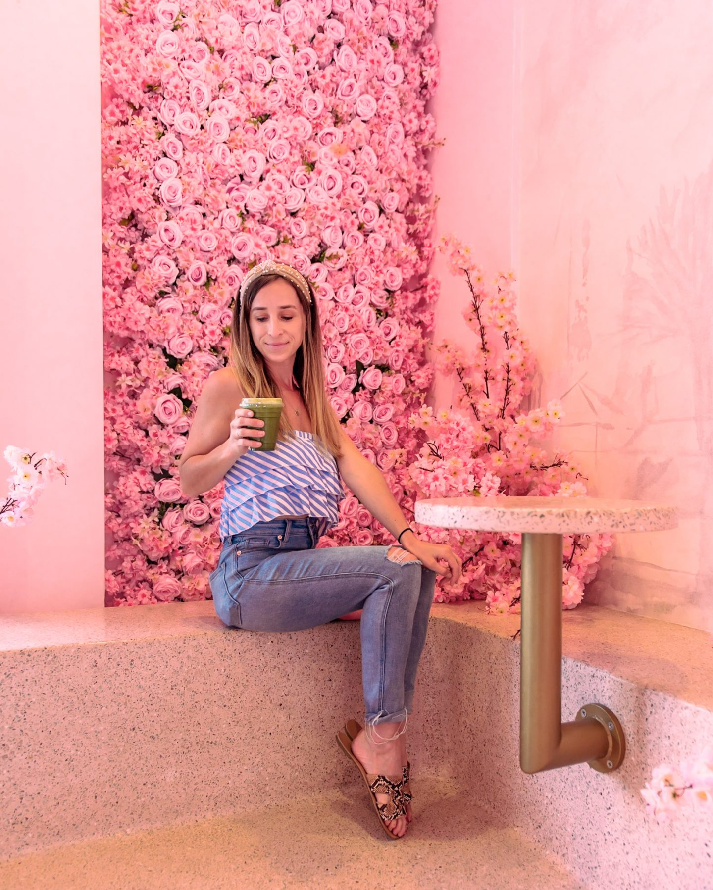 The pink floral wall at Holy matcha in downtown san diego